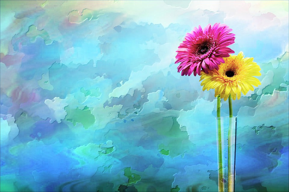 Artwork of a pink and yellow flower on a blue background
