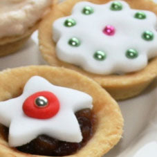 Open top mince pies with Christmas icing shapes on the top