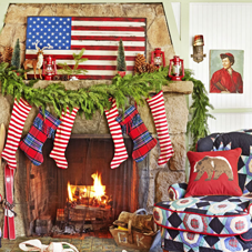 Red and white striped stockings hung on a fireplace, with USA flag above the mantel