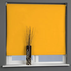 Bright yellow roller blind at a window