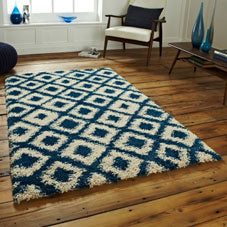 Blue and cream checked shaggy rug on wooden flooring