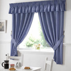 Blue kitchen curtains at a window
