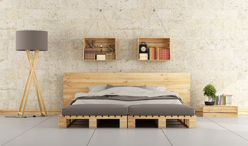 Minimalist Scandinavian bedroom with beige walls and natural wood bed made from pallets