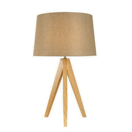 A wooden tripod floor lamp with round beige shade
