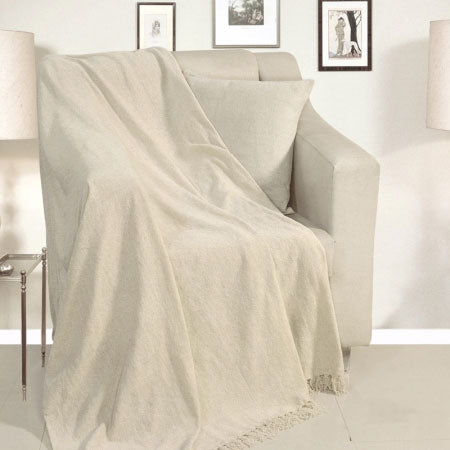 A white throw draped over a white armchair