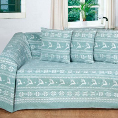 A duck egg blue throw with deer pattern completely covering a sofa