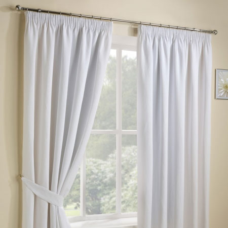 White pencil pleat curtains at a window