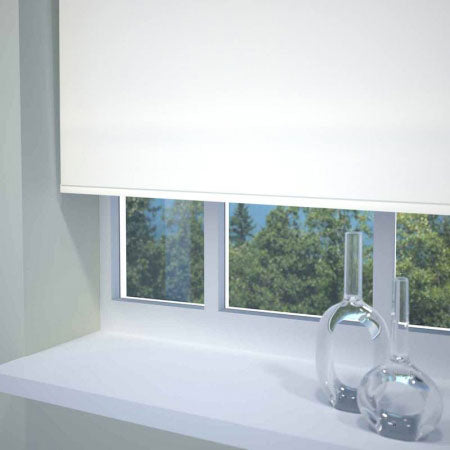 White roller blinds in a window