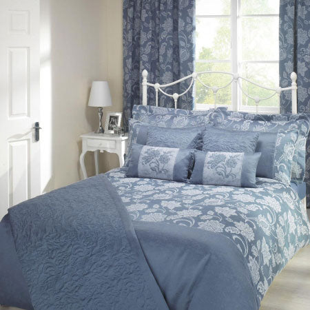 Blue bedding with intricate white floral design