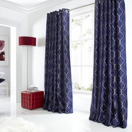 Dark blue eyelet curtains with an intricate white geometric pattern