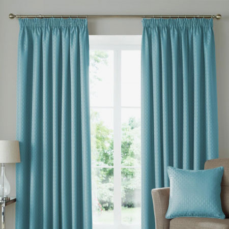 Duck egg blue pencil pleat curtains hung on a pole