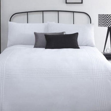 White double bedding on a black metal bed frame