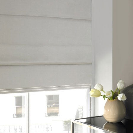 Cream made to measure roman blinds in a window
