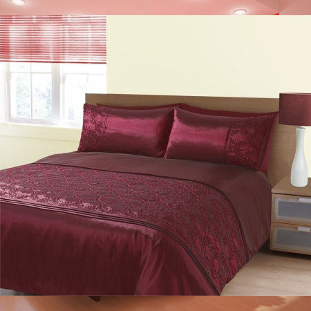 Very dark red silky bedding in a cream bedroom