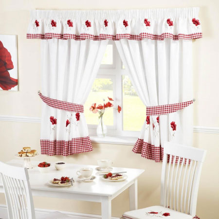 White kitchen curtains with red checked trim and red flowers