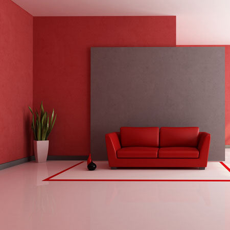 Red leather sofa in a white, red and grey modern living space