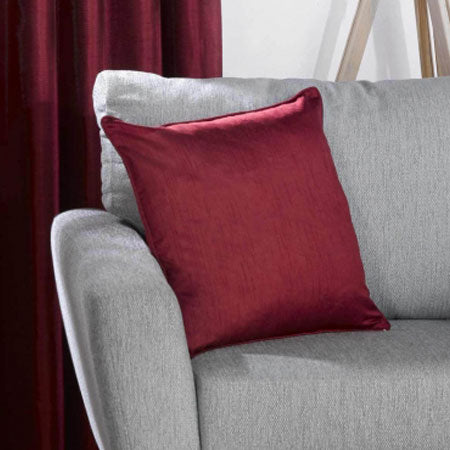 Burgundy red cushion on a grey sofa
