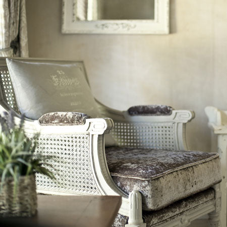 Plush seat-pad on a white wooden chair, with a cream cushion on top