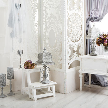 Cream dressing room with patterned privacy screen