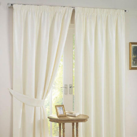 Cream pencil pleat curtains at French doors