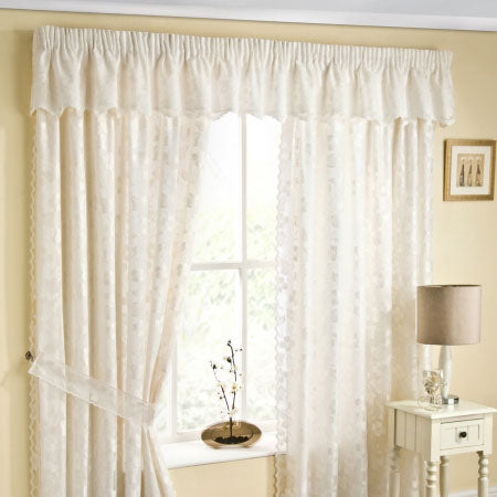 Ivory white semi plain curtains at a window in a cream living room