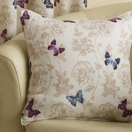 Cream armchair and cream cushion with intricate floral pattern and purple and blue butterflies