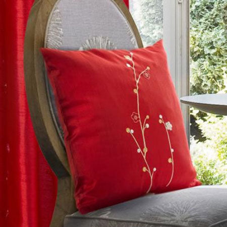 Red cushion on a grey dining chair