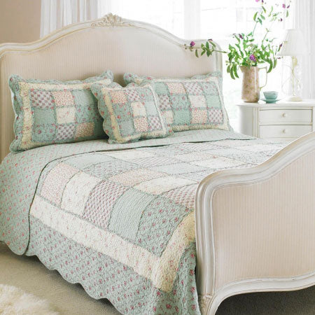 Patchwork style double bedding in light pink, cream and duck egg blue