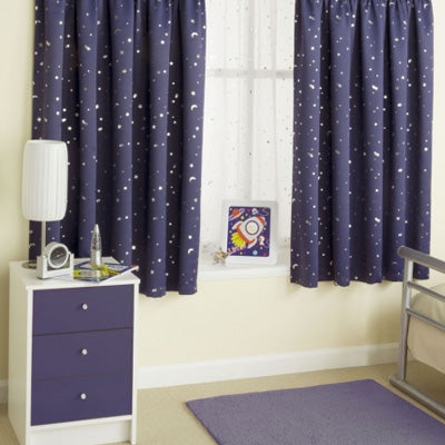 Dark blue curtains with a speckled white star design, in a kids bedroom