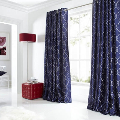 Dark blue eyelet curtains with a white geometric pattern