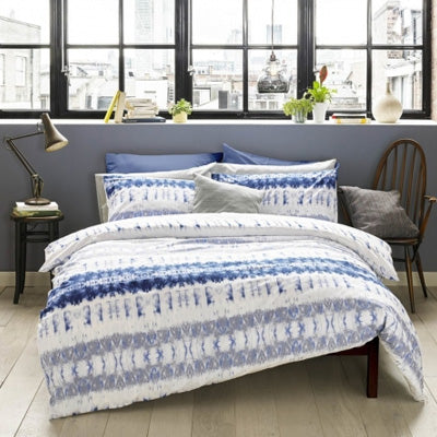 Summer Blues Inspiration - white and blue bedding with blue stripes left to right