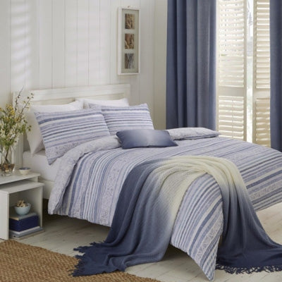 Light blue and white striped bedding, with dusky blue curtains and French shutters at the window