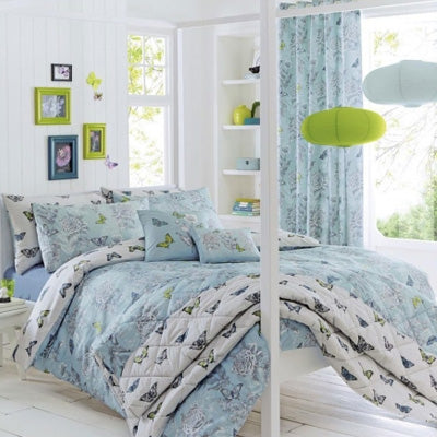 White Poster Bed With Blue and White Bedding