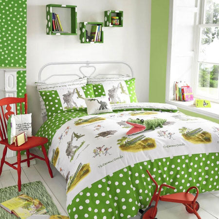Modern kids bedroom with green and white colours throughout and a crocodile stuffed toy on the bed