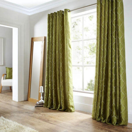 Olive green eyelet curtains with a very fine geometric pattern in a light shade of green