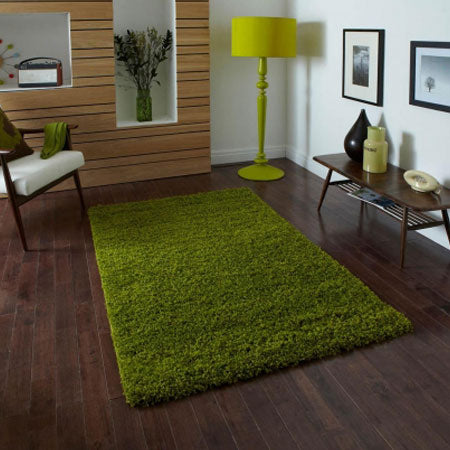 dark green shaggy rug on dark wooden flooring