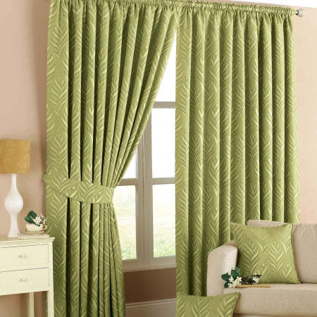 Green pencil pleat curtains at a window in a beige living room