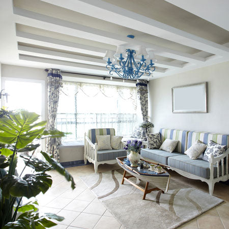 White and blue beach hut style living room, with exposed white ceiling beams