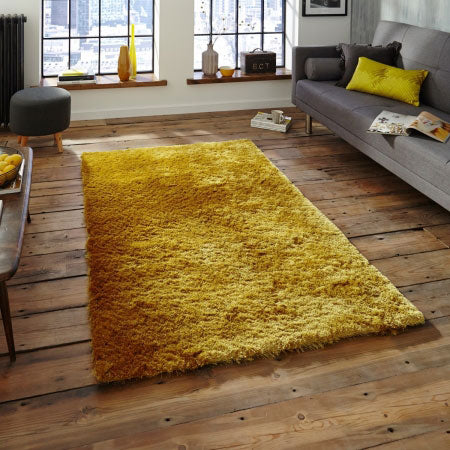 Shaggy yellow rug on a wooden floor