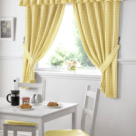 Yellow and white checked kitchen curtains and white dining table and chairs