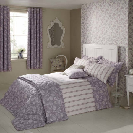 Cream, white and lavender bedroom with matching curtains and wallpaper