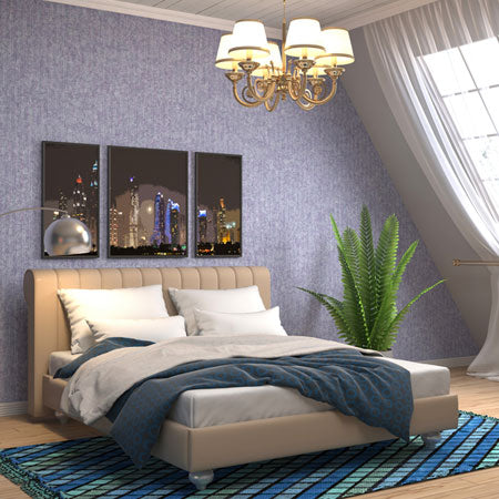 Loft bedroom with blue walls a sloping walls and cream double sleigh bed