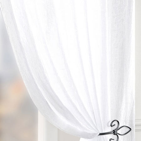 White voile curtains held back using black metal curtain tieback hooks