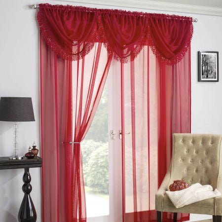 Red voile panels with matching voile pelmet at french doors