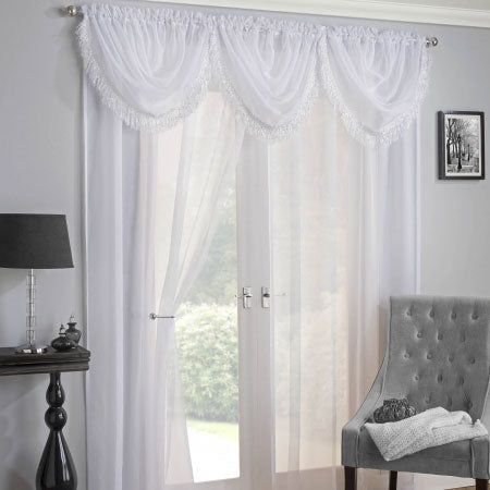 White voile panels and pelmet at a french door