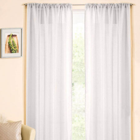 White voile curtain panels at a window