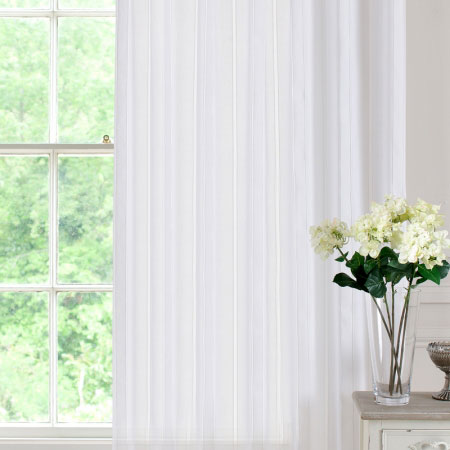 White voile panels hung at a window