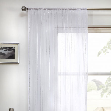 White voile on a metal pole at a window