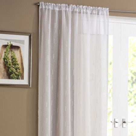 Light beige voile panel with a faint etched block pattern at a window