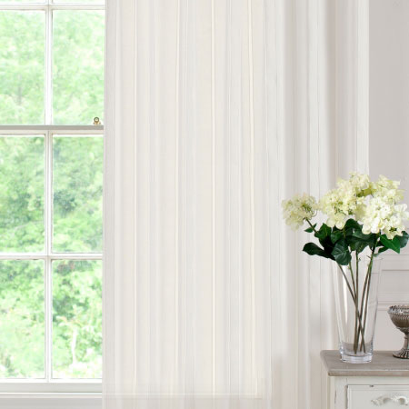 White voile panels at a window